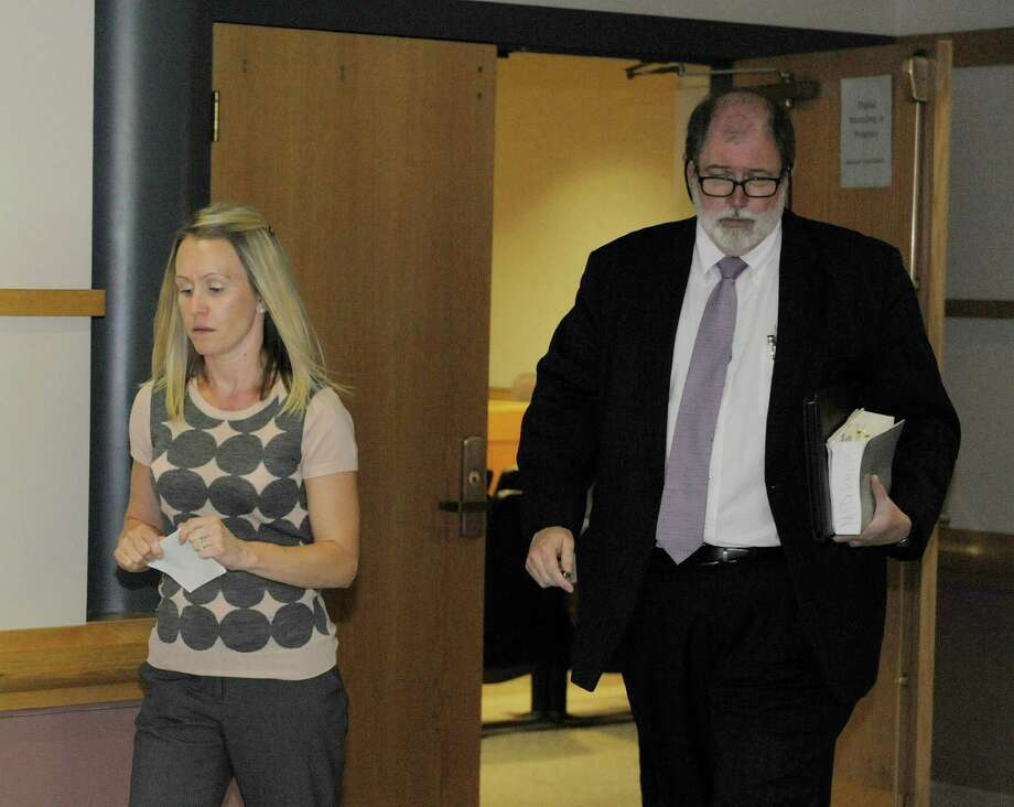Christine Quinn, left, the deputy Albany County executive and her attorney, Michael McDermott, leave Colonie Town Court Tuesday afternoon, Sept. 3, 2013,  following her arraignment in Colonie, N.Y.   (Paul Buckowski / Times Union) Photo: Paul Buckowski / 00023739A