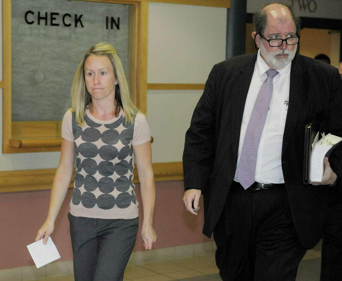 Christine Quinn, left, the deputy Albany County executive and her attorney, Michael McDermott, leave Colonie Town Court Tuesday afternoon, Sept. 3, 2013, following her arraignment in Colonie, N.Y. (Paul Buckowski / Times Union)