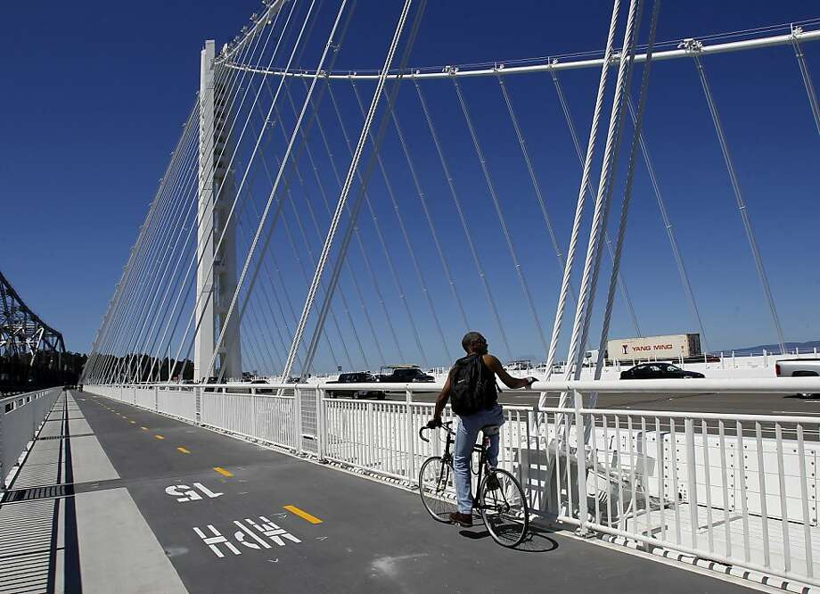 A cyclist stops to admire the view from near the suspension tower on the eastern span of the Bay Bridge. Photo: Brant Ward, The Chronicle