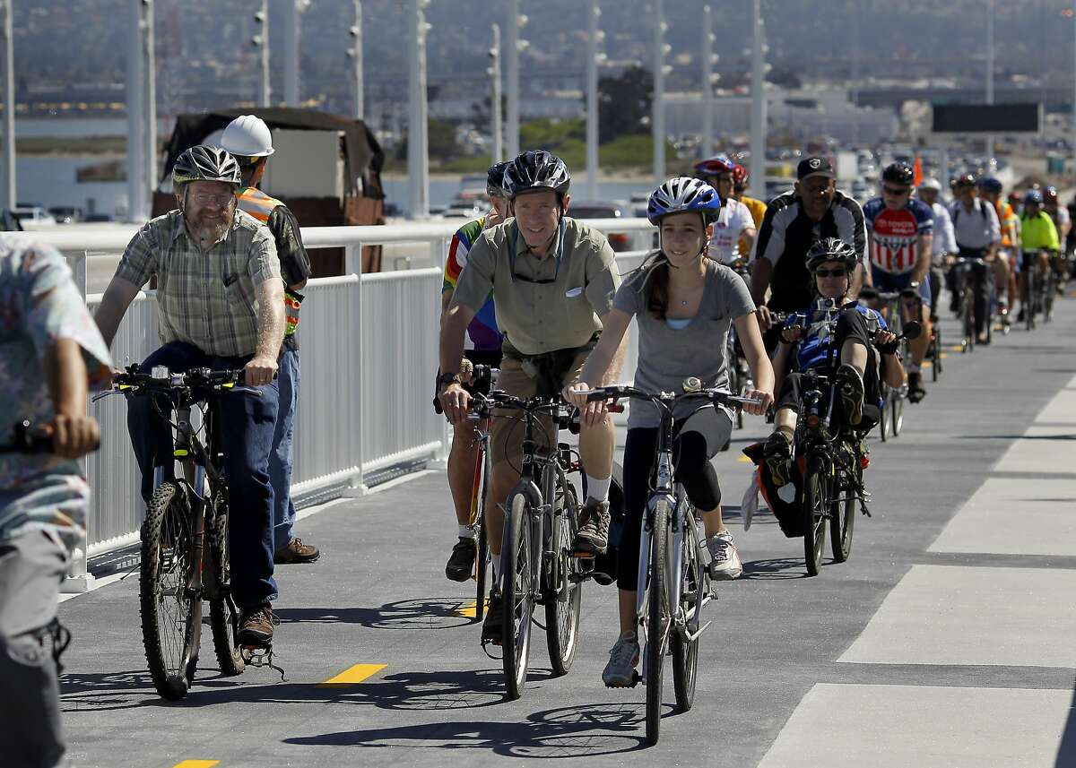 Members of the Alex Zuckermann family (center) were some of the first to make the ride named after their father and grandfather Tuesday September 3, 2013. The Alexander Zuckermann bicycle and pedestrian path on the new eastern span of the Oakland Bay Bridge was opened Tuesday.