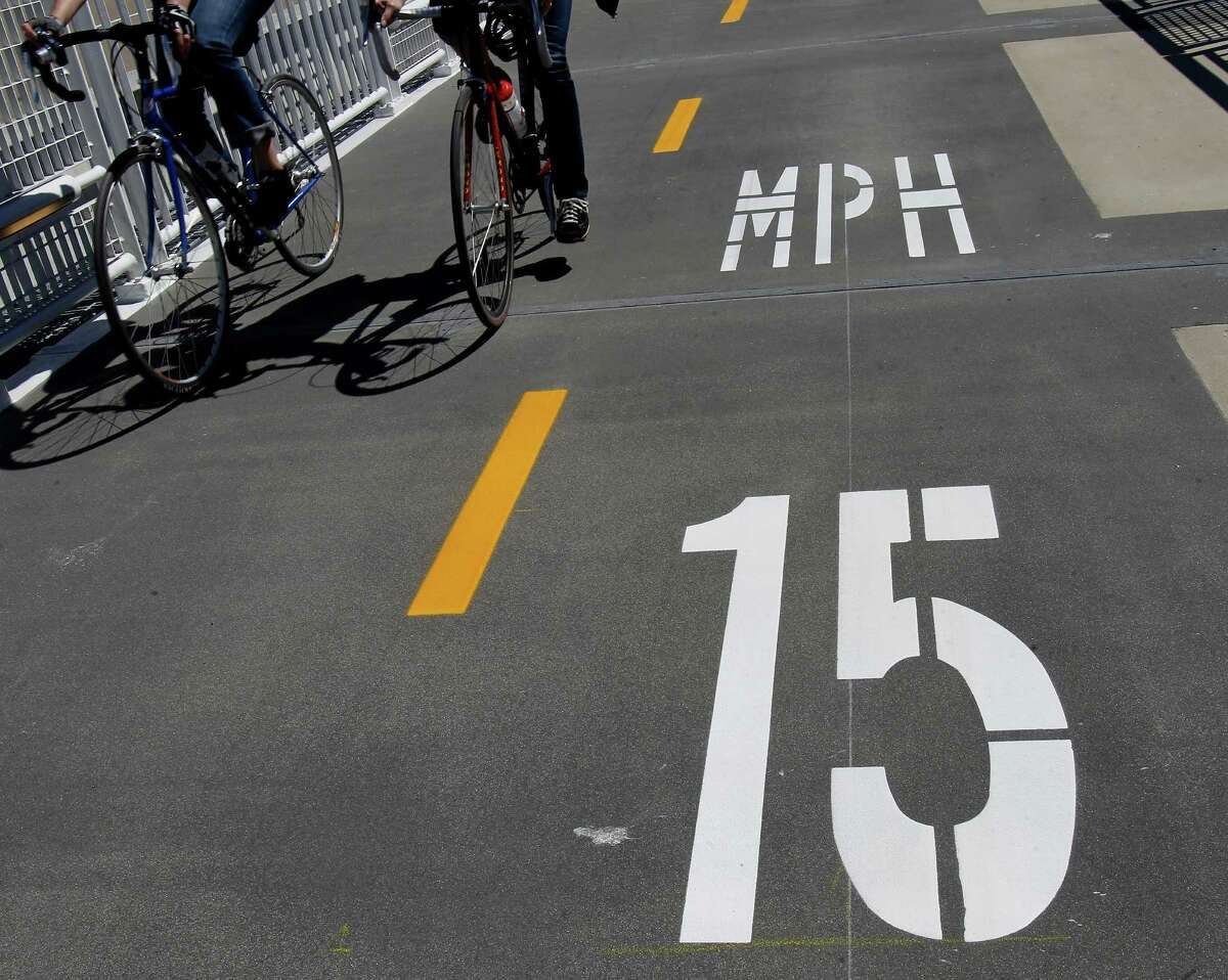 The bicycle speed limit is posted on the new path Tuesday September 3, 2013. The Alexander Zuckermann bicycle and pedestrian path on the new eastern span of the Oakland Bay Bridge was opened Tuesday.