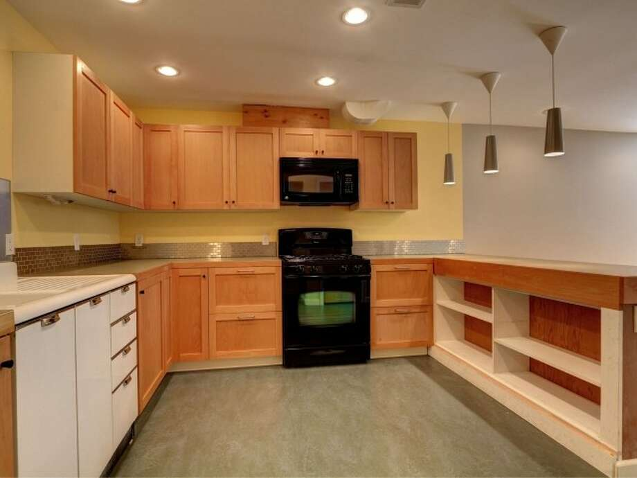 Basement kitchen of 141 N. 144th St. It's listed for $425,000. Photo: Courtesy Jeffrey Jordan, Coldwell Banker Bain