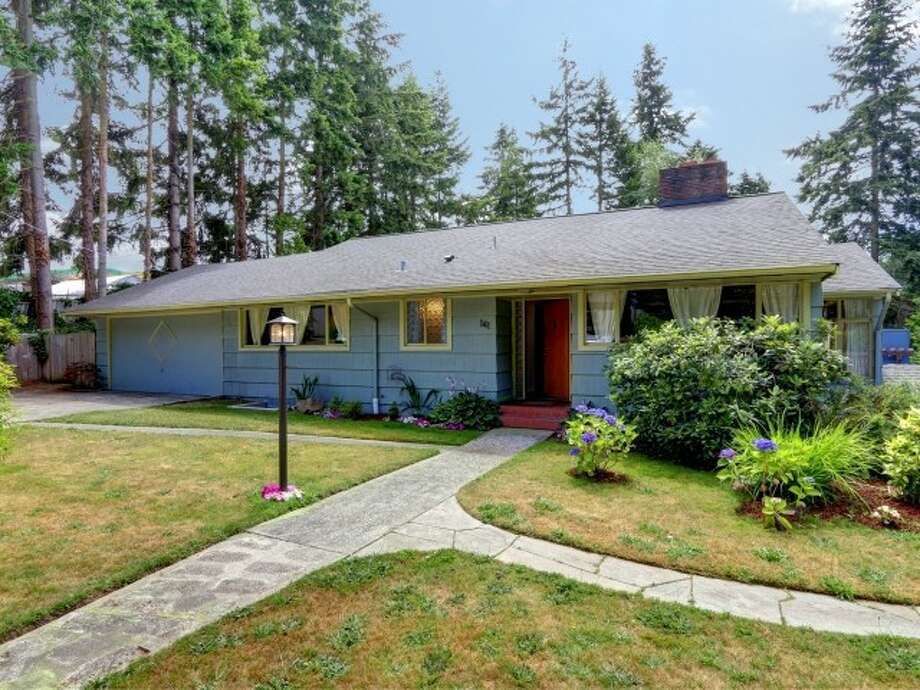 Broadview is in the Northwest corner of Seattle and contains many homes from the middle of the last century. Here are three listed for $425,000 to $450,000, starting with the lowest-priced, 141 N. 144th St. The 2,760-square-foot rambler, built in 1953, has three bedrooms, two bathrooms, two kitchens, two fireplaces, vaulted ceilings with exposed beams, a family room and a patio on a 6,602-square-foot lot. Photo: Courtesy Jeffrey Jordan,  Coldwell Banker Bain