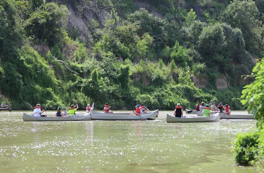 Participants canoe during a Nature Camp earlier this summer. Jesse H. Jones Park and Nature Center will host two events on invasive plants.