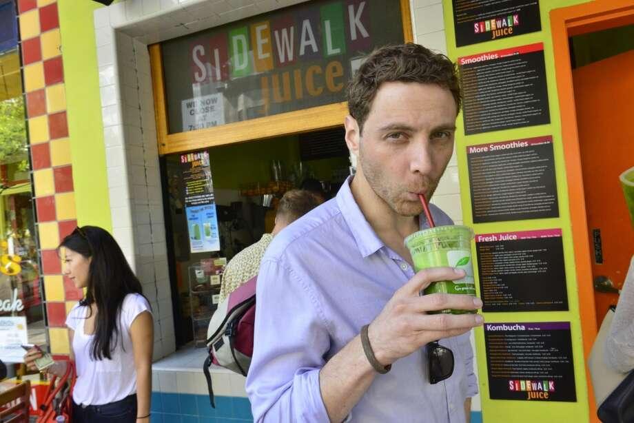 InsideHook Cofounder Jonathan Keidan looks serious about his greens at Sidewalk Juice. Photo: Jerod Harris