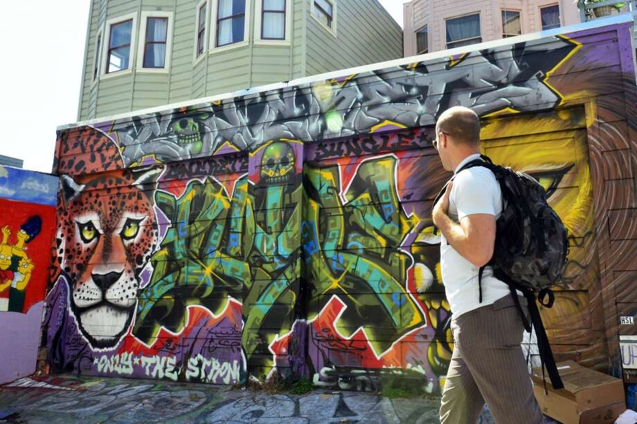 Tim Ferriss admires the Clarion Alley Mural Project. Photo: Jerod Harris