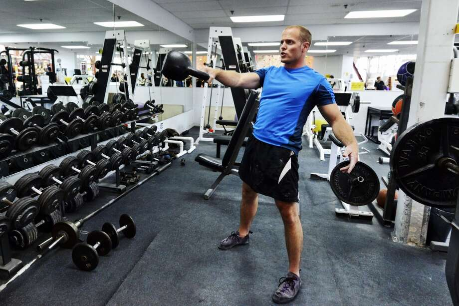 Tim Ferriss works out with a kettleball at Mission Cliffs before lunch at Salumerie. Photo: Jerod Harris