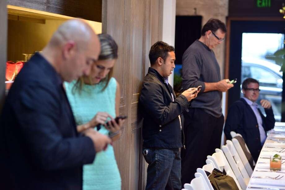 Predinner business is handled at InsideHook's launch party at Jiun Ho de Jia Gallery. Photo: Jerod Harris