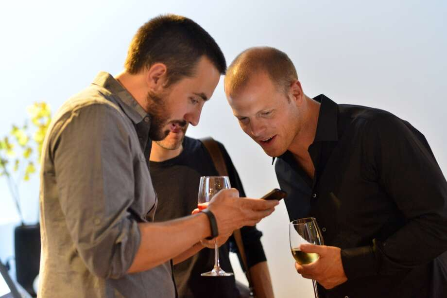 Tim Ferriss finds something amusing at  Jiun Ho de Jia Gallery during InsideHook's launch. Photo: Jerod Harris