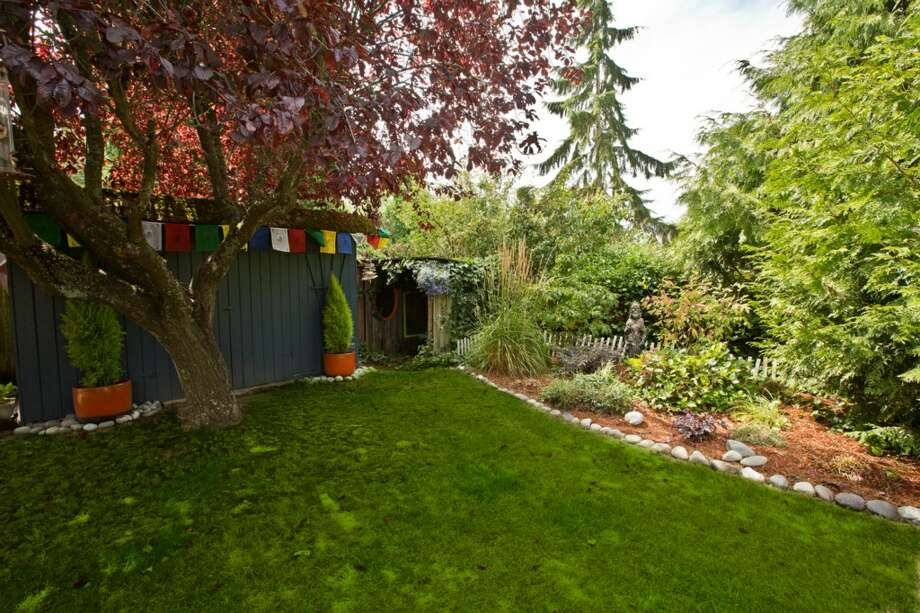 Back yard of 10735 4th Ave. It's listed for $448,500. Photo: PEEK Photography + Design, Courtesy Pamela Bowe, Coldwell Banker Bain