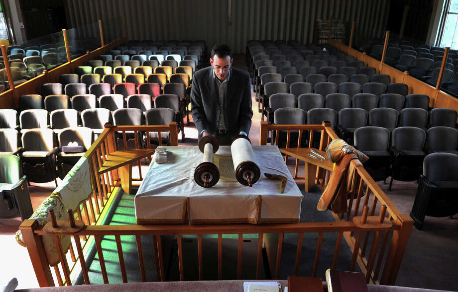 Rabbi Mitchell Rocklin, of Congregation Ahavath Achim, in Fairfield, rolls the Torah back to Genesis to get ready for Rosh Hashanah on Tuesday September 3, 2013. Photo: Christian Abraham / Connecticut Post