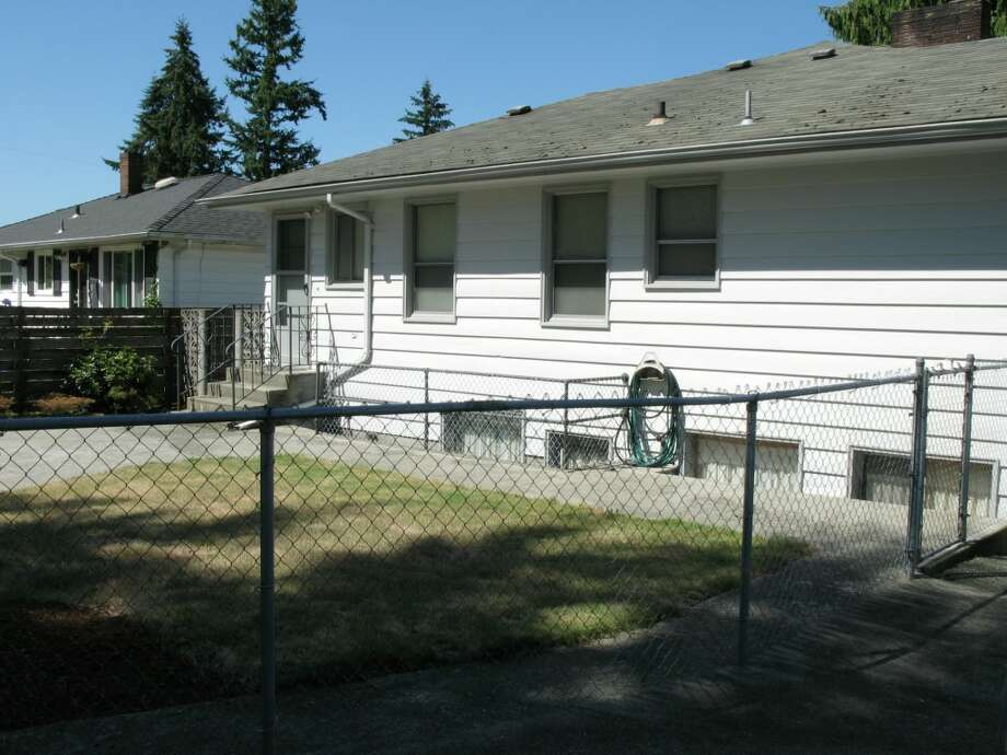 Yard of 12714 1st Ave. N.W. It's listed for $449,950. Photo: Bruce Beaton, Courtesy Wade Heyer,     Wilson Realty Exchange