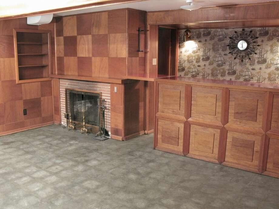 Rec room and bar of 12714 1st Ave. N.W. It's listed for $449,950. Photo: Bruce Beaton, Courtesy Wade Heyer,     Wilson Realty Exchange
