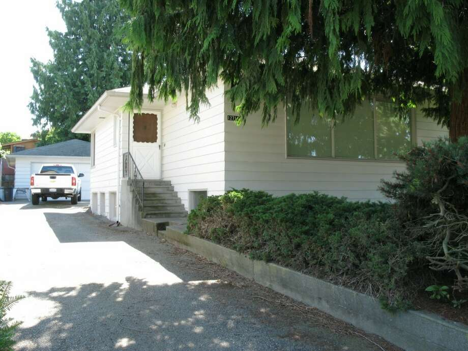 Finally, here's 12714 1st Ave. N.W. The 2,540-square-foot house, built in 1949, has three bedrooms, 1.75 bathrooms, two fireplaces, built-ins, a wood-paneled rec room with a bar, and a two-car garage. It's listed for $449,950. Photo: Bruce Beaton, Courtesy Wade Heyer,     Wilson Realty Exchange
