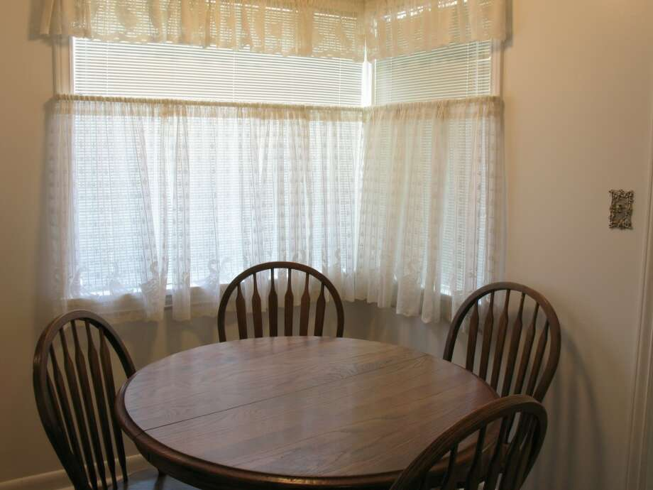 Dining room of 12714 1st Ave. N.W. It's listed for $449,950. Photo: Bruce Beaton, Courtesy Wade Heyer,     Wilson Realty Exchange