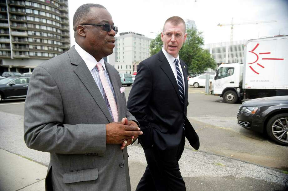 Urban Redevelopment Commission Executive Director Tommie Jackson, left, and Board Chairman Christopher Meek, right, speak during a walking tour of several sites in downtown Stamford, Conn., on Tuesday, September 3, 2013. Photo: Lindsay Perry / Stamford Advocate
