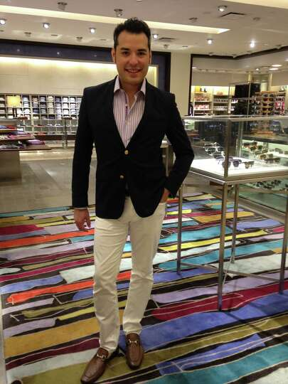 Ronny Martinez is the epitome of elegant summer cool in a striped sport shirt over white trou