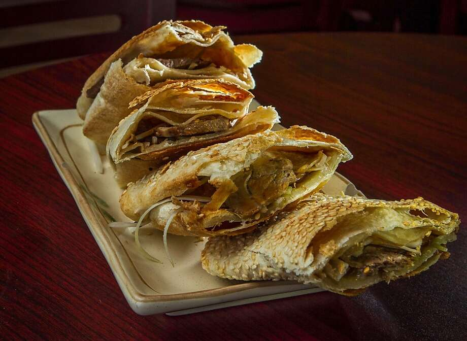Above, the sesame pancake with beef is stuffed, baked and a must-have at House of Pancakes in the Outer Sunset. Photo: John Storey, Special To The Chronicle