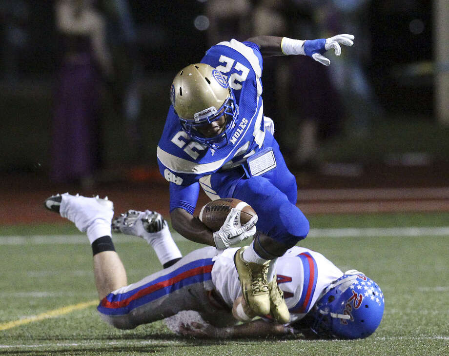 Alamo Heights' Byron Proctor (22), seen here in a Nov. 9, 2012, game vs. Buda Hays, is a key returnee for the Mules. He rushed for 1,149 yards and seven touchdowns on 175 carries as a junior last year. Photo: San Antonio Express-News File Photo