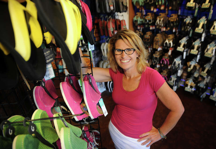 Karen Breau, owner of the new Flip Flop Shops franchise at 1552 Post Road in downtown Fairfield, Conn on Tuesday, September 3, 2013. Photo: Brian A. Pounds / Connecticut Post