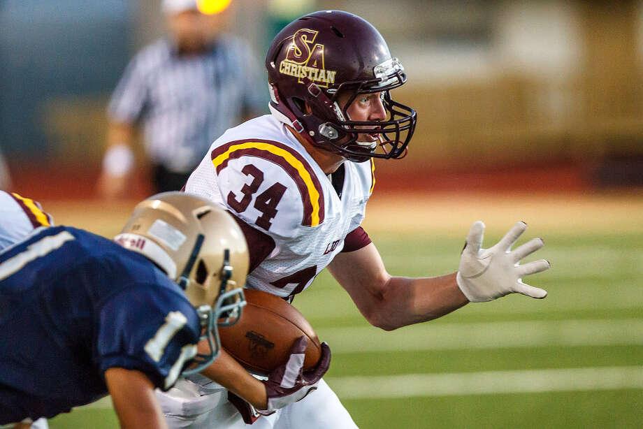 San Antonio Christian's Chase Potter, seen here in a Sept. 29, 2012, game vs. Holy Cross, is a returning all-state running back. Photo: San Antonio Express-News File Photo