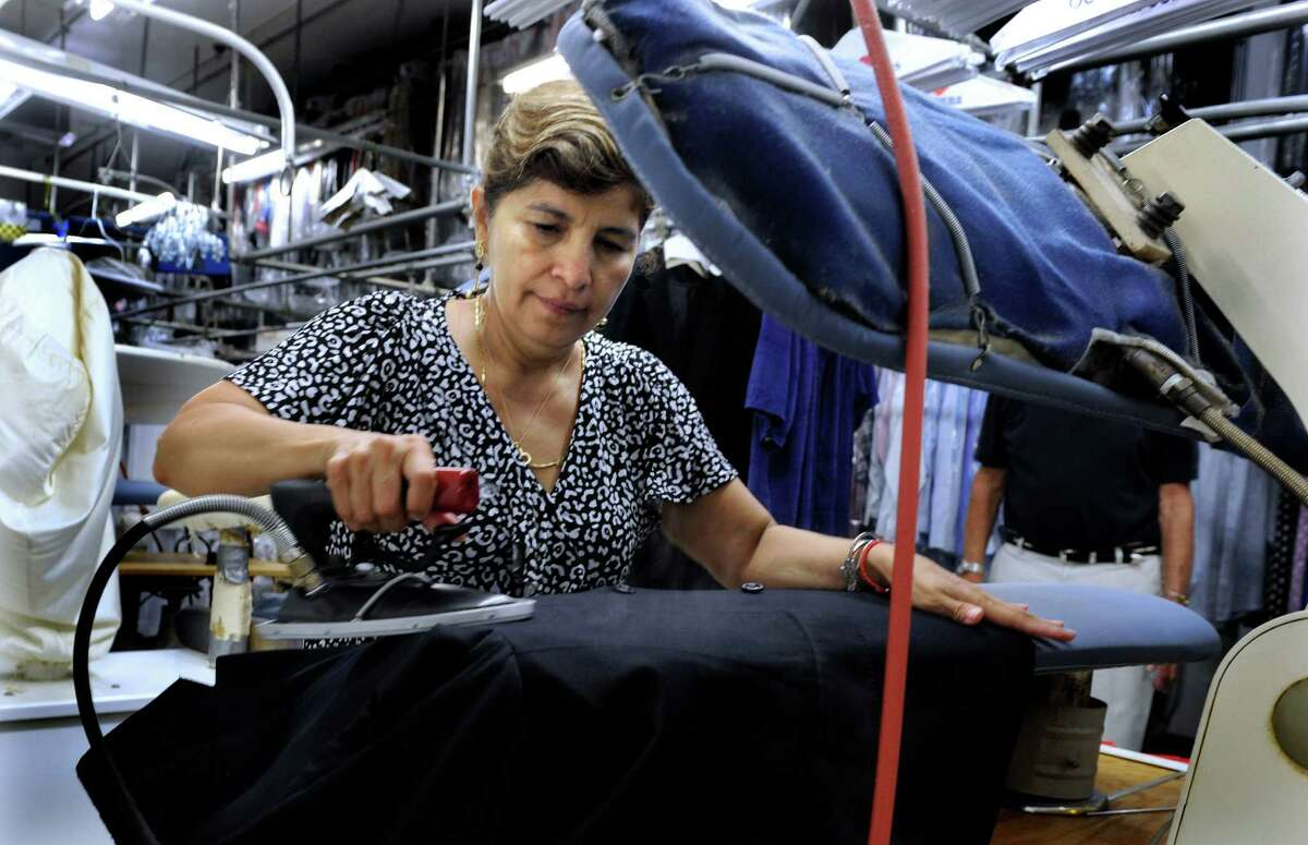 Karin Valez of Danbury, Conn., is a garment finisher at Ship Shape Cleaners in Brookfield, Conn., Tuesday, Sept. 2, 2013.