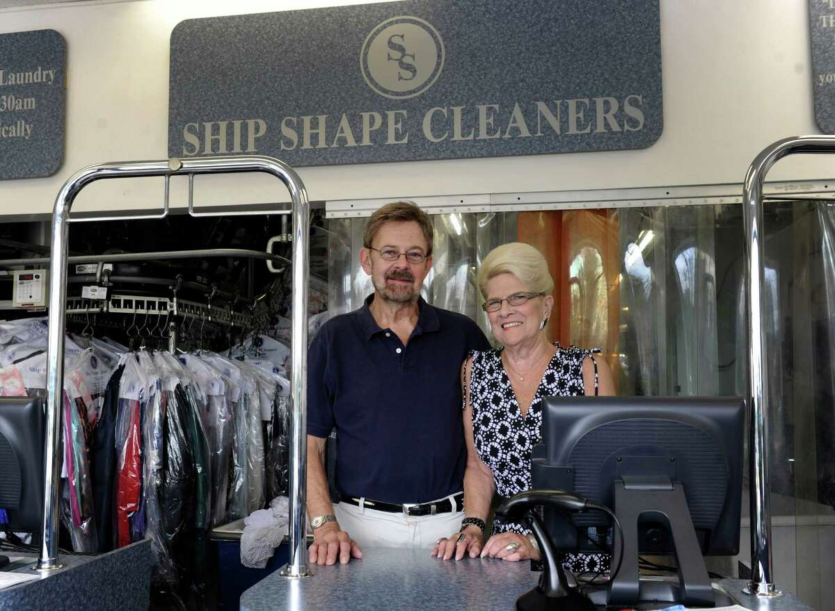 Paul and Roberta Bagley of Bethel, Conn., are photographed in their business, Ship Shape Cleaners, in Brookfield, Conn. Tuesday, Sept. 2, 2013.