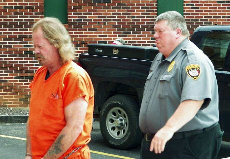 James Crocker is escorted to court for a hearing on charges stemming from his shooting a man near his property. Photo: Jim Salter, Associated Press