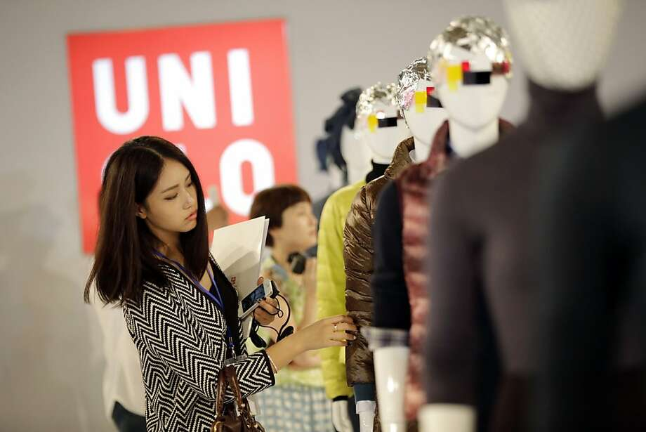 Japanese retailer Uniqlo is opening four Bay Area mall stores between Oct. 11 and Nov. 1. Photo: Eugene Hoshiko, Associated Press