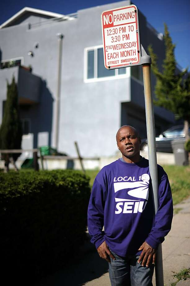Al Marshall, a lifelong Oaklander and father of 6, poses for a portrait in front of the home he lost to foreclosure 3 years ago in Oakland, CA Tuesday April 9th, 2013. Photo: Michael Short, Special To The Chronicle