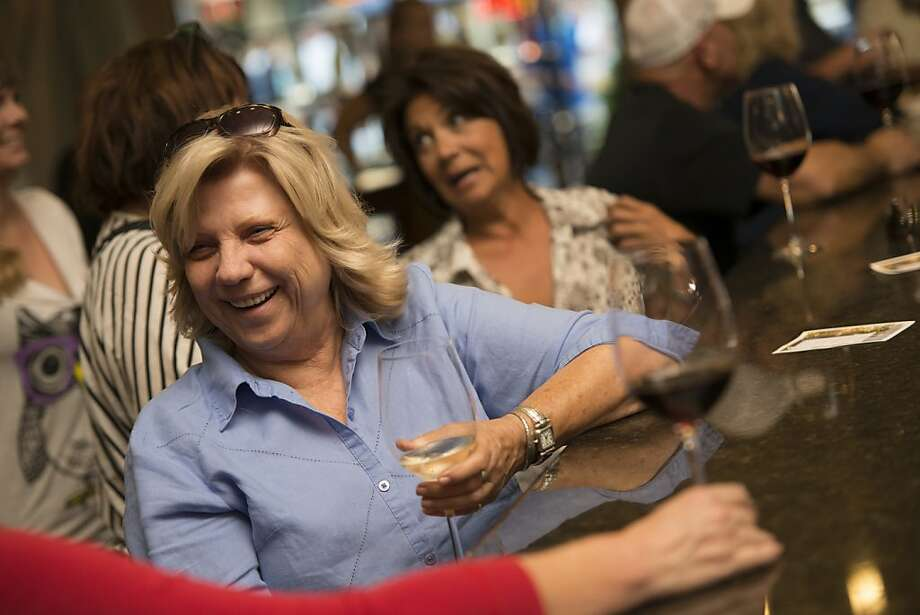 Janice Beatty of Lodi enjoys a glass of wine at the Cellardoor tasting room, which helped lead the local wine boom that locals credit for revitalizing downtown. Photo: Dan Evans