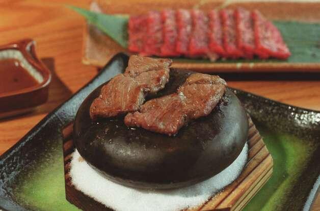 Azuma GroupAzuma Sushi & Robata Bar  Where: 5600 Kirby  Photo: hot rock beef Photo: Ben DeSoto, Houston Chronicle / Houston Chronicle