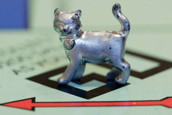 The newest Monopoly token is a cat. It beat out a helicopter and a robot in voting on Facebook.