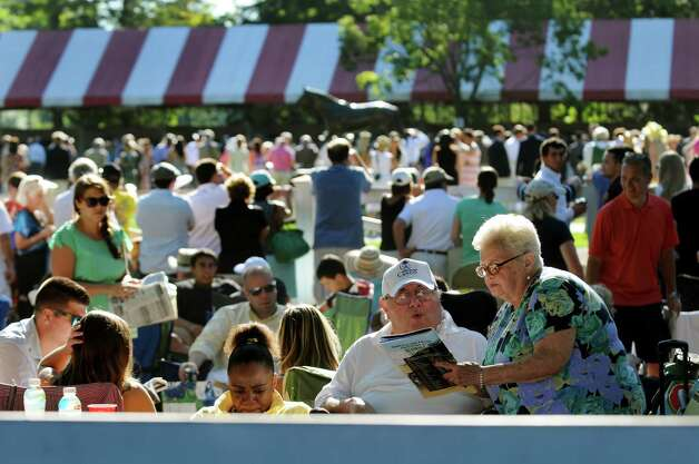 The picnic area near the paddock on Travers Day on Saturday, Aug. 24, 2013, at Saratoga Race Course in Saratoga Springs, N.Y. (Cindy Schultz / Times Union) Photo: Cindy Schultz / 00023621A