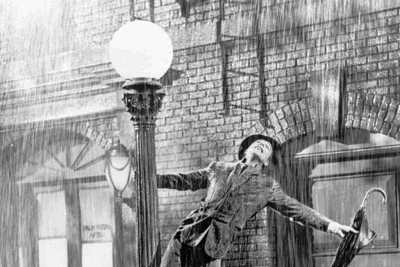 "EMBARGOED UNTIL 11 P.M. EDT, JUNE 16, 1998--FILE--Gene Kelly performs in the 1952 film ``Singin' in the Rain''.  (AP Photo/File)   HOUCHRON CAPTION (12/28/1999):     Gene Kelly performs in the film musical ""Singin' in the Rain"" (1952)."
