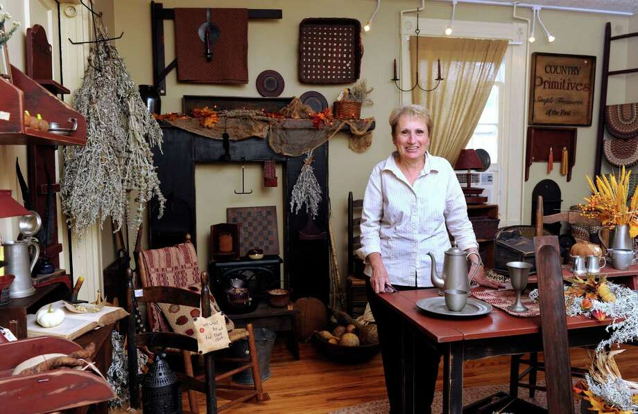 Linda Manna, 67, of Newtown, Conn., is the owner of The Country Mill in Sandy Hook. She is photographed in one of several display rooms in her shop, Tuesday, Sept. 2, 2013. Photo: Carol Kaliff / The News-Times