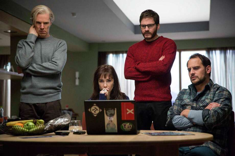 "Benedict Cumberbatch (from left), Carice van Houten, Daniel Bruhl and Moritz Bleibtreu appear in  ""The Fifth Estate."" Photo: Associated Press"