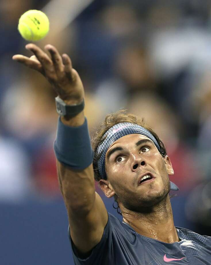 Rafael Nadal, of Spain, tosses the ball on a serve against Phillipp Kohlschreiber, of Germany, during the fourth round of the 2013 U.S. Open tennis tournament, Monday, Sept. 2, 2013, in New York. (AP Photo/Charles Krupa) Photo: Charles Krupa, Associated Press
