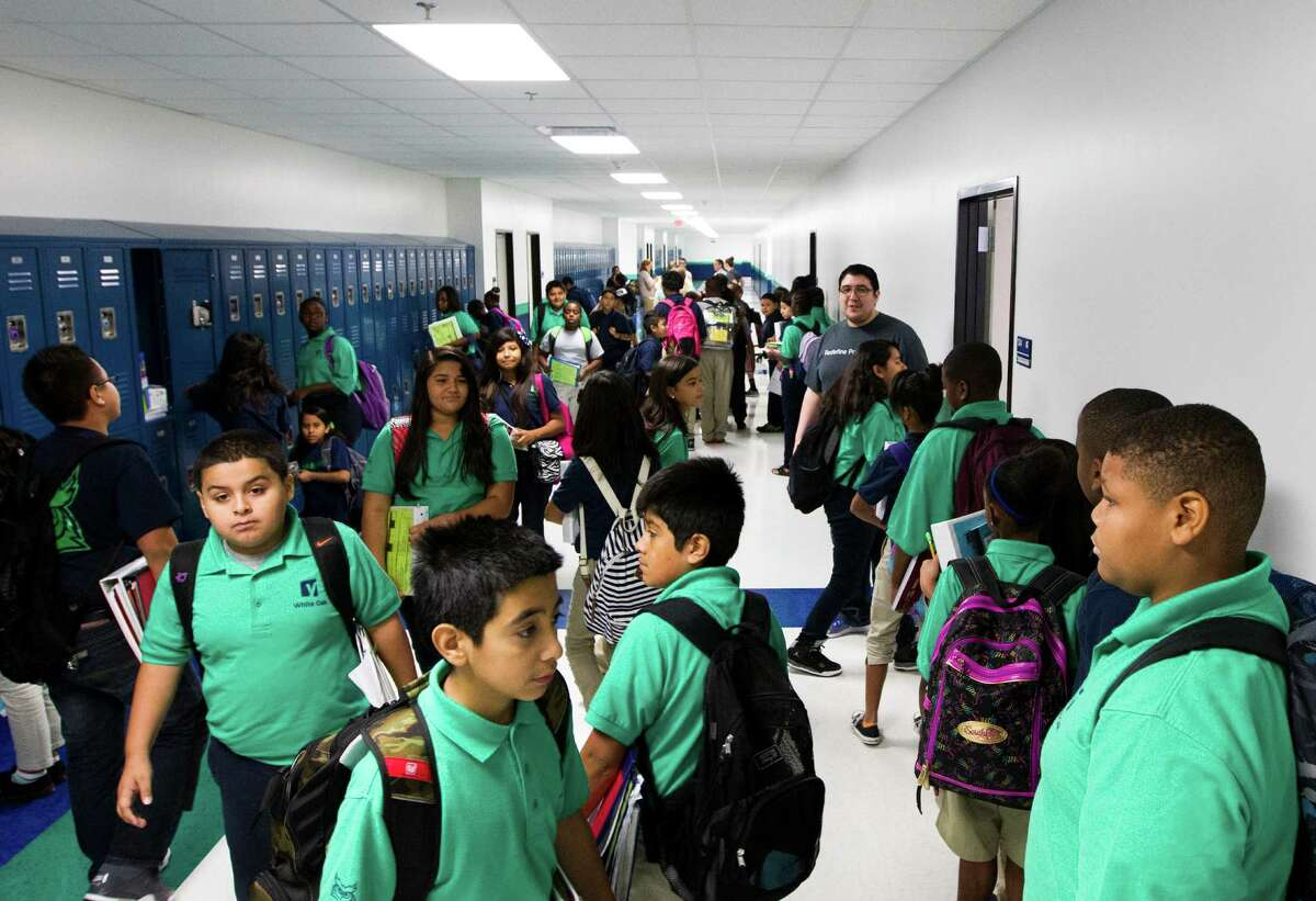 Students at Yes Prep White Oak change classes on Friday, Aug. 30, 2013, in Houston.