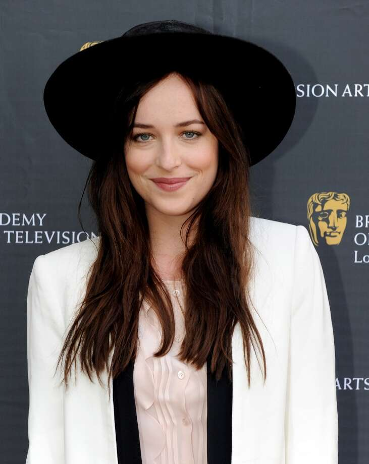 Actress Dakota Johnson arrives at the 26th Annual BAFTA LA Garden Party at the British Consul-General's official residence on June 2, 2013 in Los Angeles, Calif. Photo: Kevin Winter, WireImage