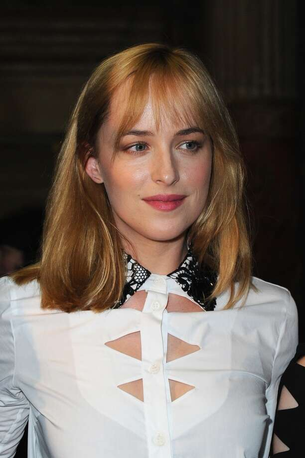 Dakota Johnson attends the Viktor & Rolf show as part of Paris Fashion Week Haute-Couture Fall/Winter 2013-2014 at La Gaite Lyrique on July 3, 2013 in Paris. Photo: Pascal Le Segretain, Getty Images