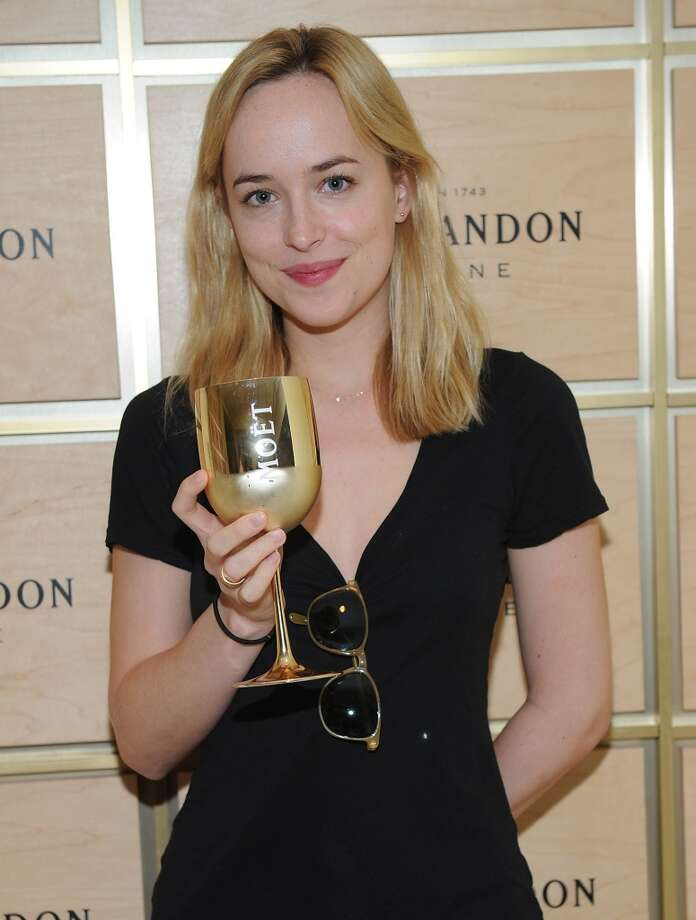 Dakota Johnson attends The Moet & Chandon Suite at the USTA Billie Jean King National Tennis Center on August 27, 2013 in New York. Photo: Brad Barket, Getty Images For Moet & Chandon
