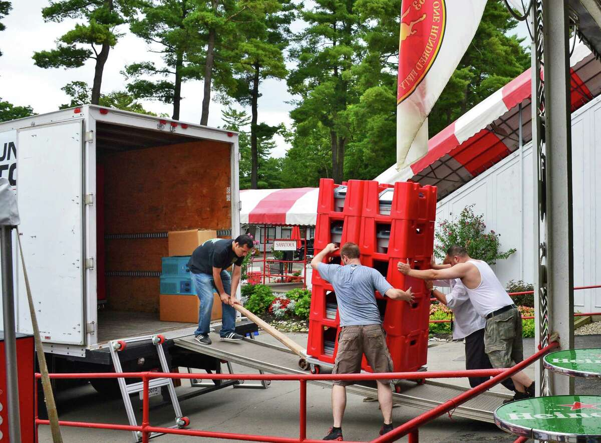 Crews load up e-terminal betting machines Tuesday morning, Sept. 3, 2013, at Saratoga Race Course in Saratoga Springs, N.Y. (John Carl D'Annibale / Times Union)