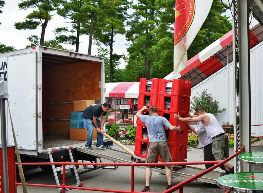 Crews load up e-terminal betting machines Tuesday morning, Sept. 3, 2013, at Saratoga Race Course in Saratoga Springs, N.Y.    (John Carl D'Annibale / Times Union) Photo: John Carl D'Annibale / 00023730A