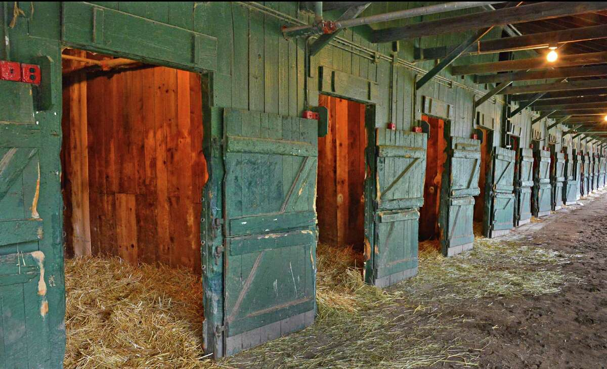 Doors open and stalls empty at this barn Tuesday morning, Sept. 3, 2013, on the backstretch of Saratoga Race Course in Saratoga Springs, N.Y. (John Carl D'Annibale / Times Union)