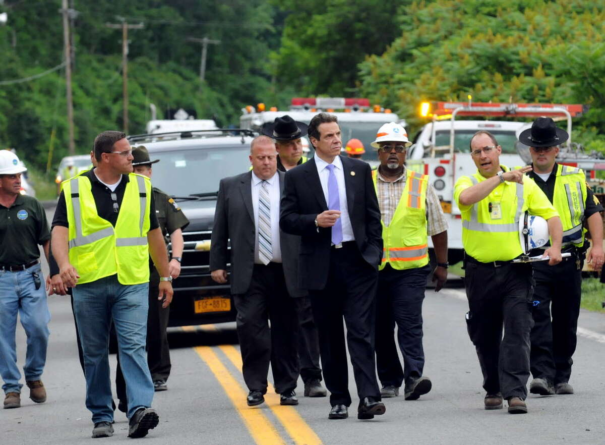Gov. Andrew Cuomo gets briefed when he visits the site of a train derailment on Thursday, June 27, 2013, in Mohawk, N.Y. (Cindy Schultz / Times Union archive)
