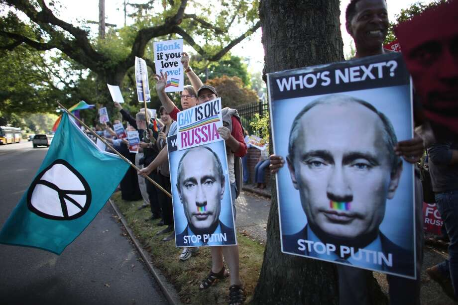 Protestors hold signs during a protest for gay rights in Russia in front of the Russian consulate on East Madison Street in Seattle. Photographed on Tuesday, September 3, 2013. Photo: JOSHUA TRUJILLO, SEATTLEPI.COM
