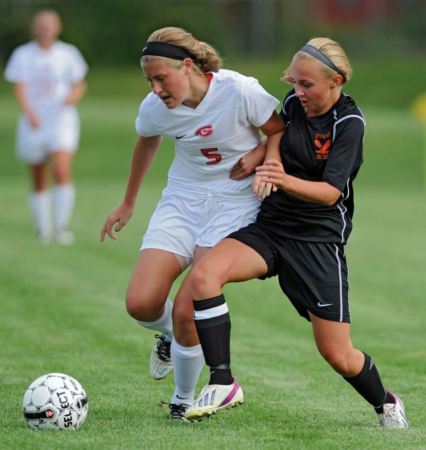 Guilderland's Katie Becker battles for the ball with Bethlehem's Lindsey Woller during a soccer game on Tuesday, Sept. 3, 2013 in Guilderland, N.Y.  (Lori Van Buren / Times Union) Photo: Lori Van Buren / 00023742A
