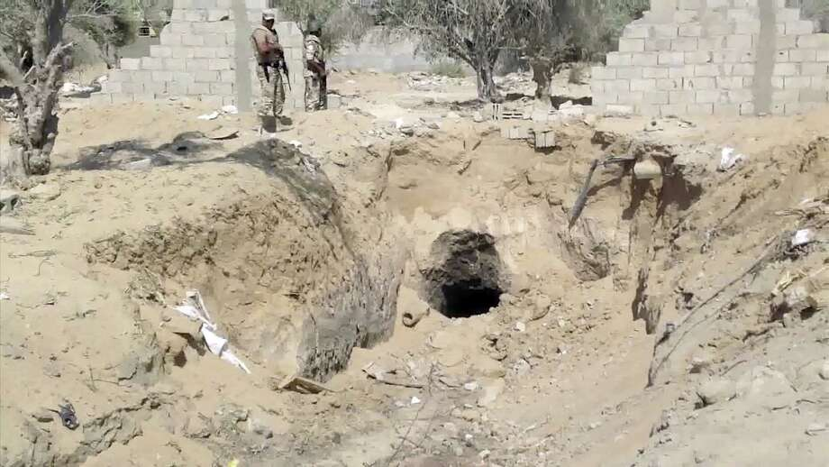 Egyptian army personnel supervise the destruction of tunnels Tuesday between Egypt and the Gaza Strip at the border, near the town of Rafah, northern Sinai, Egypt. Tunnels between Egypt and Gaza have been used to smuggle everything from weapons to cigarettes and fuel. Photo: Associated Press
