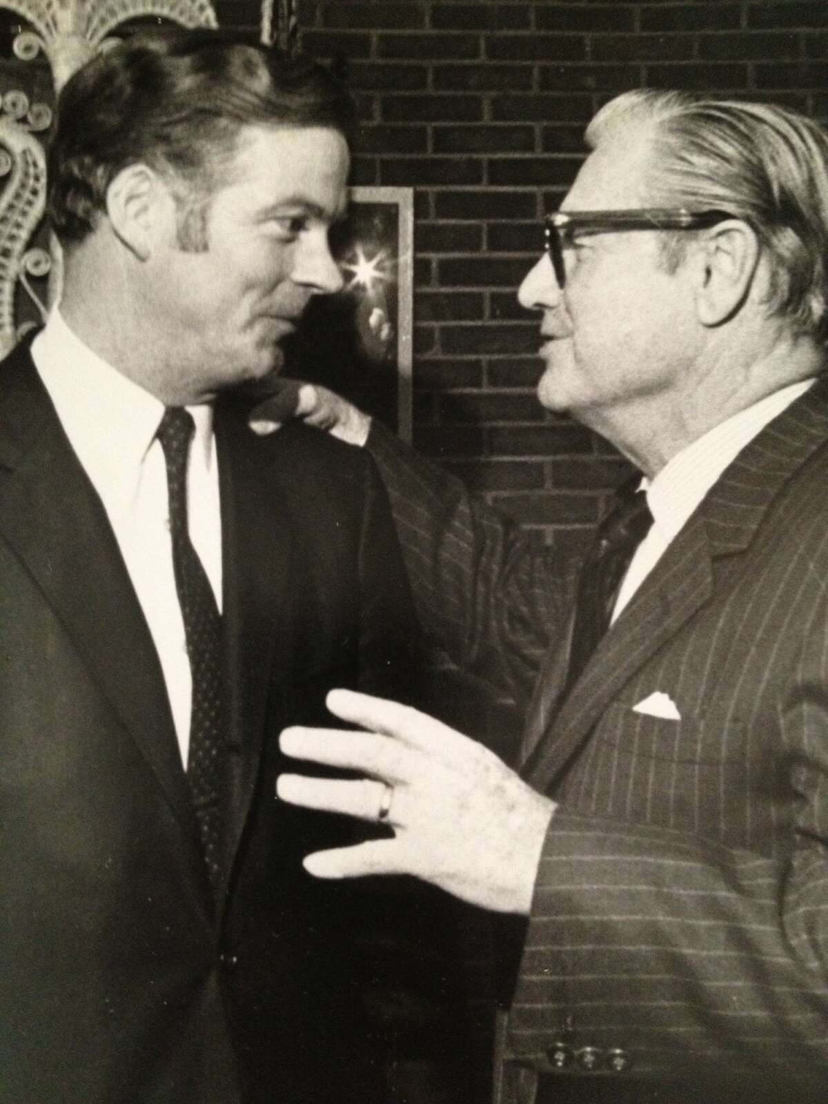Robert Bennett confers with Gov. Nelson Rockefeller at the Executive Mansion in this undated photo from Bennett's scrapbook covering his 38 years as butler and superintendent to six governors at the historic governor's residence on Eagle Street in Albany. (Photo courtesy Robert Bennett)